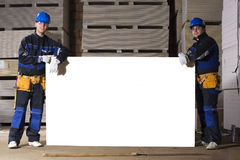 Two construction workers with white table Royalty Free Stock Photography