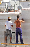 Two construction workers working on the rehabilitation of a house Stock Image