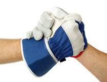 Constructors with gloves, white background. Good job. Two constructors with gloves are shaking hands Royalty Free Stock Photography
