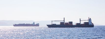 Two container ships for international transport sail full of cargo. Sea commerce, sky background, banner. Two container ships for international transport sail royalty free stock images