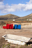 Two containers in red and blue in volcanic landscape Royalty Free Stock Images