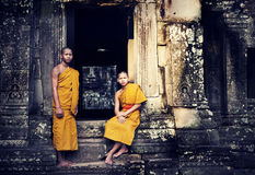 Two Contemplating Monk in Cambodia. Royalty Free Stock Photo