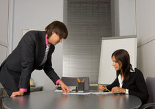 Two contemporary businesspeople at a meeting Stock Image