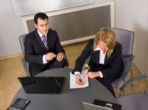 Two contemporary businesspeople at a meeting. In the office royalty free stock photography