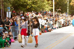 Two Contemporary Witches Walk Halloween Parade Route Royalty Free Stock Image