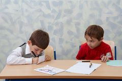 Two contrast schoolboys Royalty Free Stock Image