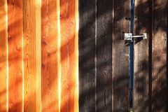 Two contrasted colors wooden fences Stock Images