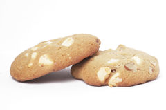 Two Cookie Biscuits With White Chocolate And Nuts. Two Cookie Biscuit With White Chocolate And Macadamia Nuts, Plain Background stock photo