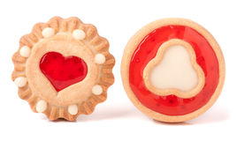 Two cookie with jelly and heart on a white background Royalty Free Stock Images