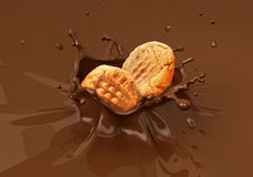 Two cookies biscuits falling into liquid chocolate splashing. Close up view Stock Photos