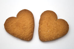 Two cookies in the form of hearts - symbol of love Royalty Free Stock Photo