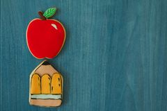 Two cookies with shape of a pencil and an apple Stock Image
