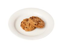 Two cookies on a small plate Royalty Free Stock Photo