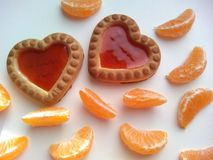 Two cookies and tangerines cloves Stock Image