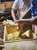 Cooks making dough for Tortillas on a kneading trough royalty free stock images