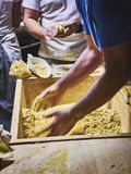 Cooks making dough for Tortillas on a kneading trough stock images