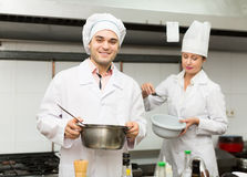 Two cooks at restaurant kitchen Stock Photo