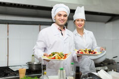 Two cooks at restaurant kitchen Stock Photos