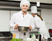 Two cooks at restaurant kitchen Royalty Free Stock Photography