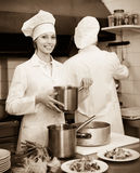 Two cooks at restaurant kitchen Stock Image