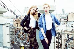 Two cool blond real girls friends making selfie on roof top, lif stock photos