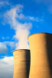 Two cooling tower in geothermal energy power station on sunset. Royalty Free Stock Image