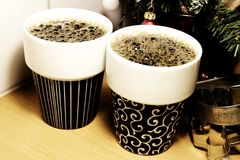 A pair of porcelain coffee cups filled with freshly brewed coffee royalty free stock photo
