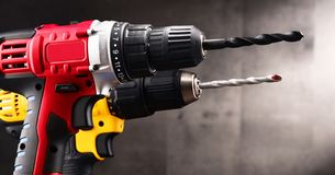Two cordless drills with drill bits working also as guns.  royalty free stock image
