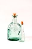 Two corked bottles. 2 clear glass bottles with corks photographed on a white background Royalty Free Stock Photo