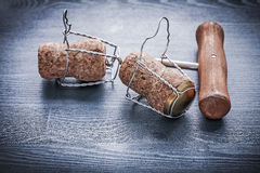Two corks with wires of champagne and corkscrew Stock Photo