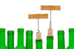 Two corkscrew, wine cork and the bottle Royalty Free Stock Photography