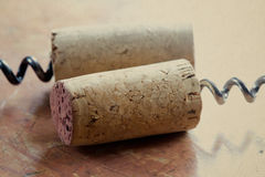 Two corkscrew with wine corks. close-up Royalty Free Stock Image