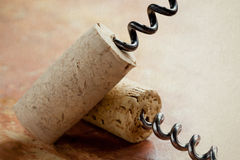 Two corkscrew with wine corks. texture, soft focus Royalty Free Stock Photo