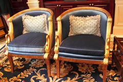 Two corner chairs Stock Photos