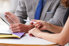 Two corporate business colleagues at work, close up of hands Royalty Free Stock Images