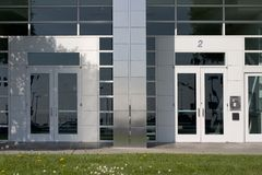 Two Corporate Doors. Two doors leading to the inside of a no-name generic corporation royalty free stock photo