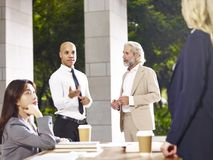 Two corporate executives debating during meeting. Multiethnic corporate business executives discussing debating during meeting Royalty Free Stock Photo