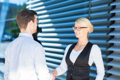 Two corporate workers shaking hands outdoor Royalty Free Stock Photography