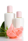 Two cosmetic bottles with rose Stock Photo