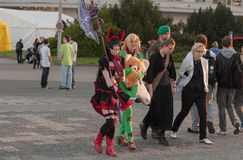 Two cosplayers dressed as the character Elin from game Tera Royalty Free Stock Images