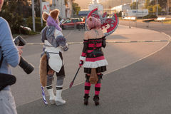 Two cosplayers dressed as the character Elin from game Tera Stock Photo