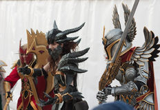 Two cosplayers dressed as the characters Neltharion and Paladin. BRNO, CZECH REPUBLIC - APRIL 30, 2016:Two cosplayers dressed as characters Neltharion(World of stock photography