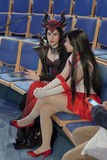 Two cosplayers dressed as characters Ruby Dragon and girl from anime Stock Photo