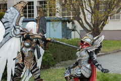 Two cosplayers dressed as the characters Uriel and Haven  Paladi. BRNO, CZECH REPUBLIC - APRIL 30, 2016: Two cosplayers  dressed as characters Uriel  and Haven Royalty Free Stock Photos