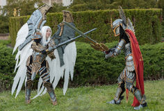 Two cosplayers dressed as the characters Uriel and Haven Paladin. BRNO, CZECH REPUBLIC - APRIL 30, 2016: Two cosplayers  dressed as characters Uriel and Haven Royalty Free Stock Image