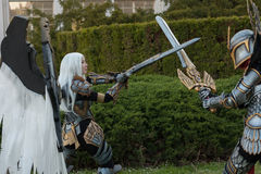 Two cosplayers dressed as the characters Uriel and Haven Paladin. BRNO, CZECH REPUBLIC - APRIL 30, 2016: Two cosplayers dressed as characters Uriel and Haven Stock Images