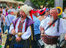 Two cossacks at the All-Ukrainian fair crowded with people Royalty Free Stock Photo