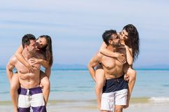 Two Couple On Beach Summer Vacation, Young People Happy Smiling, Man Carry Woman Sea Ocean Royalty Free Stock Image