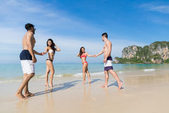 Two Couple On Beach Summer Vacation, Young People In Love Walking, Man Woman Holding Hands Sea Ocean. Holiday Travel Stock Photos