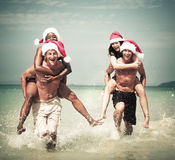 Two couple celebrating on the beach Concept Royalty Free Stock Images